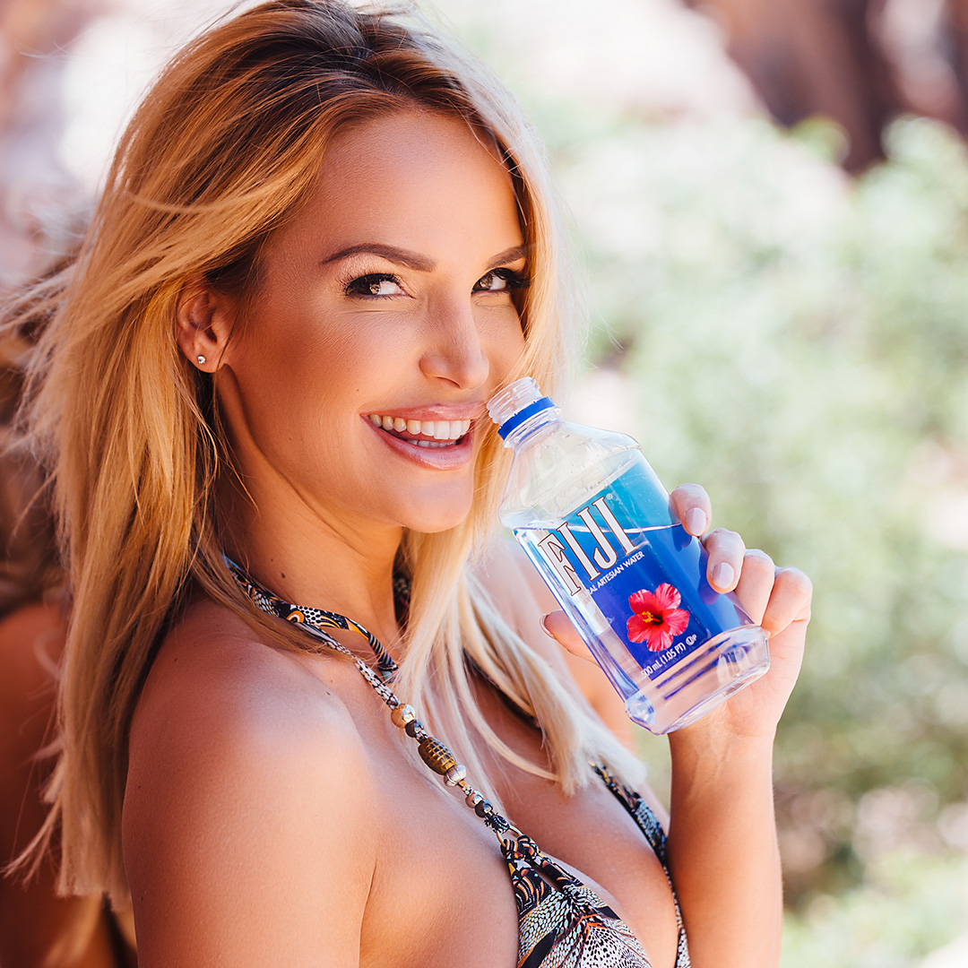 Tropic Beauty model drinking Figi brand water